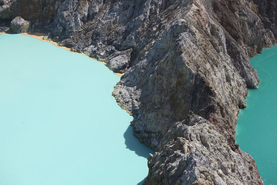 Colourful crater lakes of Kelimutu volcano separated by crater wall, Flores, Indonesia