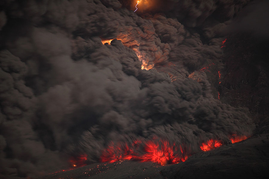 Nighttime pyroclastic flow with lightning, Sinabung volcano, 2014